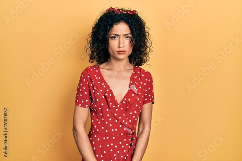 Stampa su Tela Young latin girl wearing summer dress skeptic and nervous, frowning upset because of problem