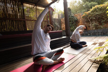 Diverse Couple Wearing Sportswear And Practicing Yoga On Yoga Mat