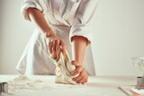 Fototapeta Kawa jest smaczna - baker rolling dough flour cooking