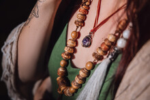 Wooden Beads On The Neck Of A Woman In Boho Style