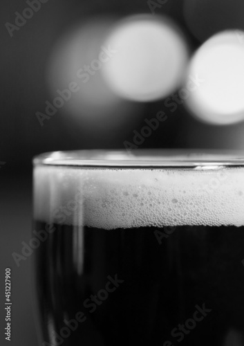 Composition of black and white glass of beer