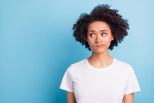 Portrait Of Young Unhappy Upset Thoughtful Minded Afro Girl Look Copyspace Thinking Isolated On Blue Color Background
