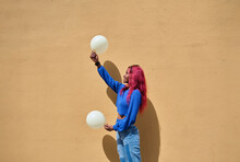 Ethnic Woman With Balloons Near Wall