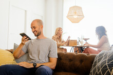 Man Recording Voice Message On Smartphone