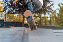 Skater Performing Trick On Ramp In Skate Park