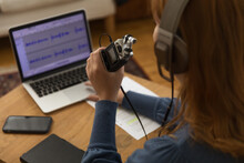 Anonymous Woman Recording Podcast At Home