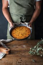 Crop Man Holding Plate With Pumpkin Pie