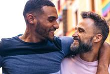 Happy Multiethnic Homosexual Boyfriends On City Street