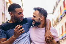 Happy Gay Couple With Smartphone