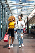 Delighted Black Women During Shopping In Mall