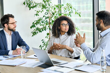 Diverse International Executive Business People Discussing Financial Report At Boardroom Meeting Table. Multiracial Team Having Sales Seminar Workshop Developing Business Strategy Plan In Office.