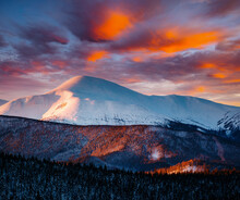Incredible Sunset In A Mountain Valley On A Frosty Evening. Image Of A Bright Epic Sky.