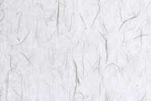 Thin Silk Fibers Decorated Paper Background. Decorative Yunlong Kam Paper Texture. Landscape Horizontal Orientation.