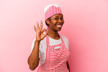 Young African American Ice Cream Maker Woman Isolated On Pink Background Cheerful And Confident Showing Ok Gesture.