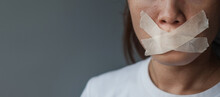 Woman With Mouth Sealed In Adhesive Tape. Free Of Speech, Freedom Of Press, Human Rights, Protest Dictatorship, Democracy, Liberty, Equality And Fraternity Concepts