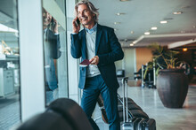 Businessman At Airport Waiting Lounge