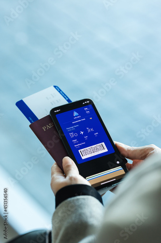 Traveler at airport using digital boarding pass phone app