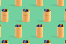 Colored Crayons Pattern Composition On Pastel Green Background. Waxy Pencils Eco Cardboard Box Isometric. Colorful Wax Pastel Paper Case Writing Art Drawing. Back To School Artistic Education Concept