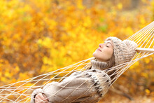 Woman Sleeping On Hammock In A Forest In Autumn