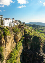 Ronda, Spain: Landscape Of White Houses On The Green Edges Of Steep Cliffs