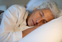 Senior Caucasian Woman In The Bedroom, Lying In The Bed And Sleeping