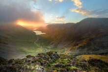 Sun Breaking Through Clouds Onto Mountain Landscape In The Lake District With View Of Buttermere And Fleetwith Pike. Cumbria, UK.