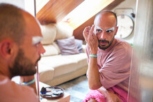 Bearded Man Applying Drag Queen Makeup