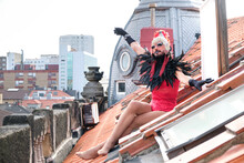 Drag Queen Sitting On Roof In City