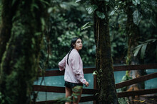 Travelling Woman Standing Near River In Jungle