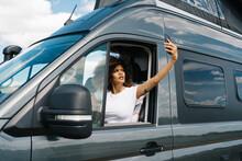 Woman With Smartphone In Broken Car