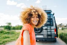 Black Female Traveler Leading Friend To Camper