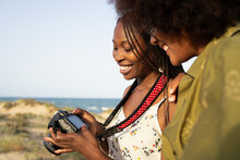 Happy Black Girlfriends With Photo Camera In Summer Nature