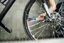 Crop Man Cleaning Gear Cassette Of Bike Wheel