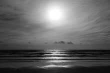 Mysterious Scene Of Glowing Light Reflecting Onto Waves; Taken At Tyrella Beach Overlooking The Irish Sea.