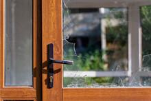 Modern Door With Handle And Broken Glass.