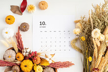 Flat Lay With Calendar For October With Autumn Table Decoration