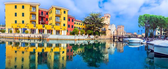 Scenic lake of northern Italy Lago di Garda. Colorful charming Sirmione town and Scagligero castle