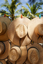Straw Hat Hanging On Wires