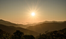 Sun Flare Over Layers Of Smoky Mountains