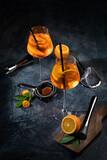 Fototapeta Kawa jest smaczna - Aperol spritz cocktail served on dark background.