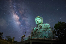Daibutsu Or 'Giant Buddha' Is A Japanese Term Often Used Informally For A Large Statue Of Buddha, Giant Buddha With Milky Way In Sky At Night, Mae Tha District, Lampang Province