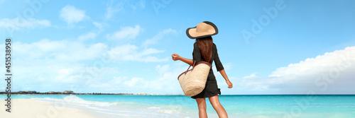 Beach vacation luxury travel woman tourist walking on pristine resort holiday hotel waterfront banner panoramic. Caribbean summer getaway lifestyle.