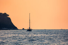 Sailing Ship With Raised Sails Laying For Anchor Near The Coast Of Ancona Italy