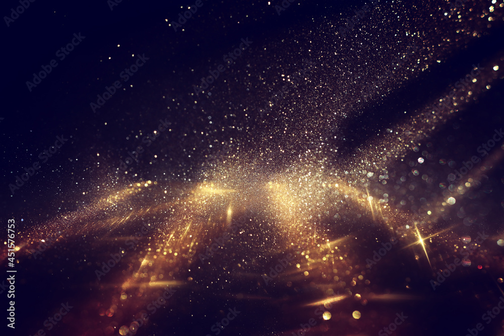 background of abstract gold and black glitter lights. defocused