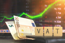 European Taxes, VAT Concept, Vat Word And Euro Money Banknotes On Stock Chart Background. Business And Economic Photo