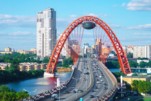 The Picturesque Bridge Over The Moscow River (Zhivopisny Bridge) And A  Car Traffic Over It
