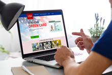 Laptop With Permanent Resident Card Of USA Website