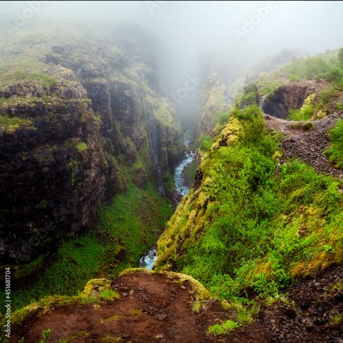 Glymur green moss Waterfall cascade canyon hiking over Botsna river of Iceland