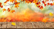 orange fall  leaves and old wooden board, autumn natural background