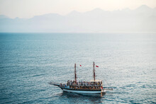 Seascape With A Lonely Ship In The Mediterranean. Boat Trip On A Tourist Ship. Sights And Travels Of Turkey.